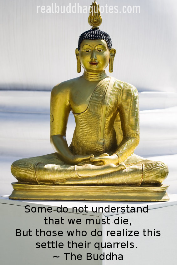 Golden statue of seated Buddha in lotus position